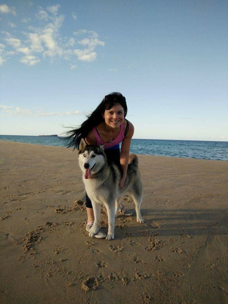 Bianca Millroy with her dog on t he beach